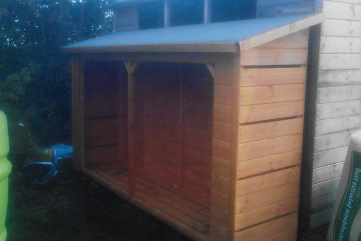 Large wooden log store with ventilation